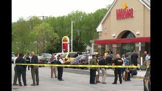 Gunman pursued injured officer seeking cover, fired again