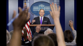 The Latest: Trump spokesman calls Flynn probe