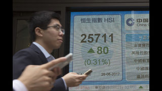 Asian shares mixed as oil