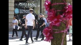 The Latest: UK eases terror threat level