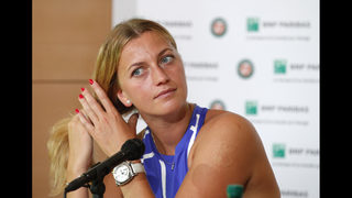 Back on court after knife attack, Kvitova wins in Paris