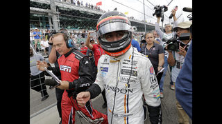 F1 champion Alonso swigs milk at Indy, just not as winner