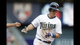 Road wins key so far for surprising Twins, Brewers