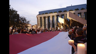 The Latest: Hungary to protect Poland from EU