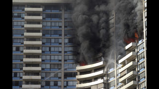 Few US cities mandate sprinklers in old residential towers