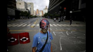 Deaths in Venezuela unrest hit 101 as polarizing vote nears