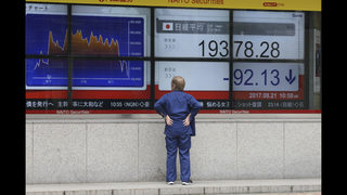 World shares mostly down ahead of key central banker meeting