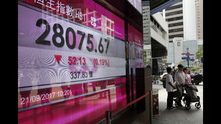 World shares mixed as markets mull latest Fed statement