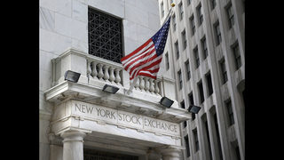 Banks lead US stocks mostly higher in morning trading