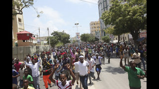 The Latest: Somalis gather at stadium to protest al-Shabab