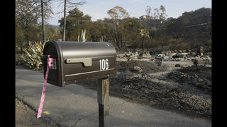 California wildfire victims search burned homes for memories