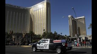 The Latest: Slain Vegas officer buried at veterans cemetery