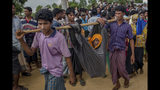 The Latest:  Revised aid tally from Rohingya meeting: $344M