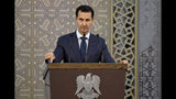 Russian state TV: Assad travels to Russia, meets with Putin
