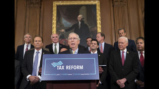 The Latest: Trump praises deal on GOP tax cuts