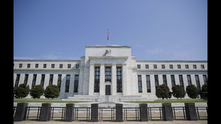 The Latest: China raises key policy rate after Fed