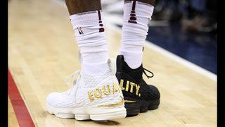 LeBron wears 1 black shoe, 1 white shoe saying