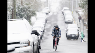Frigid temperatures trail storm dropping more snow on South