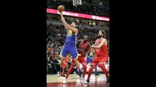 Warriors beat Bulls 119-112 for 14th straight road win