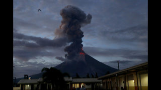 Philippine volcano spreads lava almost 2 miles from crater