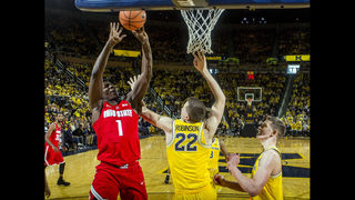 No. 22 Michigan tops No. 8 Ohio St 74-62, helps other rival