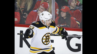Marchand stays hot with OT winner against Flames