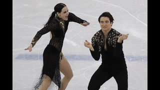 The Latest: Canadian ice dancers vie for more medals
