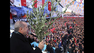 The Latest: Turkey denies reports that Syria will aid Kurds