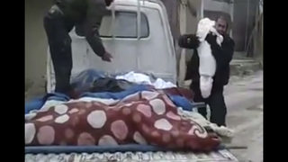 In Syria, a father says last goodbye to dead child