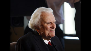 Billy Graham mourned as body taken to his namesake library