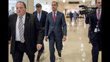 Former Trump campaign manager Cory Lewandowski, center, and his lawyer Peter Chavkin, second from left, arrive to meet behind closed doors with the House Intelligence Committee, at the Capitol in Washington, Thursday, March 8, 2018. (AP Photo/Andrew Harnik)