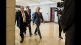 President Donald Trump's former campaign manager Cory Lewandowski, center, and his lawyer Peter Chavkin, second from left, arrive to meet behind closed doors with the House Intelligence Committee, at the Capitol in Washington, Thursday, March 8, 2018. (AP Photo/Andrew Harnik)