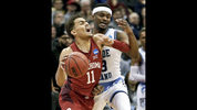 Oklahoma's Trae Young (11) tries to get past Rhode Island's Stanford Robinson during the first half of an NCAA men's college basketball tournament first-round game, Thursday, March 15, 2018, in Pittsburgh. (AP Photo/Keith Srakocic)