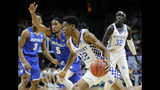 Kentucky guard Shai Gilgeous-Alexander (22) drives against Buffalo guard CJ Massinburg (5) during the first half of a second-round game in the NCAA men's college basketball tournament Saturday, March 17, 2018, in Boise, Idaho. (AP Photo/Otto Kitsinger)