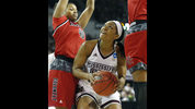 Mississippi State guard Victoria Vivians, center, looks for an opening past Nicholls players to attempt a layup during the second half of a first-round game in the NCAA women's college basketball tournament in Starkville, Miss., Saturday, March 17, 2018. Mississippi State won 95-50. (AP Photo/Rogelio V. Solis)