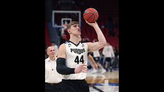 NCAA Latest: Minus Haas, Purdue leads Butler 40-36 at half
