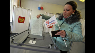 The Latest: Putin casts ballot in Russia
