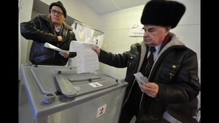 Russia votes but outcome is clear: 6 more years of Putin