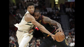 LeBron gets triple-double, Cavs beat Bucks without Lue