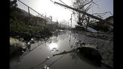 FILE - In this Sept. 26, 2017 file photo, downed power lines and debris are seen in the aftermath of Hurricane Maria in Yabucoa, Puerto Rico. Exactly six months after being hit by the hurricane the U.S. territory is still struggling to recover from the strongest storm to hit the island in nearly a century. (AP Photo/Gerald Herbert, File)