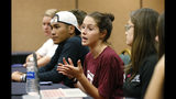 In this, Wednesday, March 14, 2018 photo, Casey Sherman, center, 17, lead student coordinator for the Parkland march, speaks during a planning meeting with Marjory Stoneman Douglas High School students, parents and volunteers in a hotel meeting room in Coral Springs, Fla. The students from Marjory Stoneman Douglas High School have spearheaded what could become one of the largest marches in history. Organizers say they are expecting perhaps 1 million people in the nation's capital Saturday, March 24. More than 800 sister marches are planned from California to Japan.(AP Photo/Wilfredo Lee)