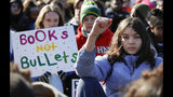 FILE- This March 14, 2018 file photo shows Students sitting in silence as they rally in front of the White House in Washington. Students walked out of school to protest gun violence in the biggest demonstration yet of the student activism that has emerged in response to last month's massacre of 17 people at Florida's Marjory Stoneman Douglas High School. In the wake of a Valentine's Day shooting, a handful of Parkland, Fla., teenagers are on the cusp of pulling off what could be one of the largest marches in history with nearly 1 million expected in DC and more than 800 sister marches planned across every continent. (AP Photo/Carolyn Kaster, File)