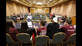 In this March 14, 2018 photo, Casey Sherman, center, 17, lead student coordinator for the Parkland, Fla., march, speaks during a planning meeting with Marjory Stoneman Douglas High School students, parents and volunteers in a hotel meeting room in Coral Springs, Fla. The students from Marjory Stoneman Douglas High School have spearheaded what could become one of the largest marches in history. Organizers say they are expecting perhaps 1 million people in the nation's capital Saturday, March 24. More than 800 sister marches are planned from California to Japan. (AP Photo/Wilfredo Lee)