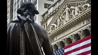 US stocks hold steady a day after big loss on trade worries