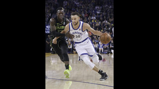 Curry returns, then injures left knee as Warriors beat Hawks
