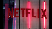 FILE- In this Nov. 4, 2017, file photo, the logo of American entertainment company Netflix is pictured at the Paris games week in Paris. Netflix, Inc. reports earnings Monday, April 16, 2018. (AP Photo/Christophe Ena, File)