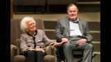 FILE - In this March 8, 2017, file photo, the Mensch International Foundation presented its annual Mensch Award to former U.S. President George H.W. Bush and former first lady Barbara Bush at an awards ceremony hosted by Congregation Beth Israel in Houston. A family spokesman said Tuesday, April 17, 2018, that former first lady Barbara Bush has died at the age of 92. ( Steve Gonzales/Houston Chronicle via AP, File)