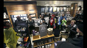 Demonstrators occupy the Starbucks that has become the center of protests Monday, April 16, 2018, in Philadelphia. Starbucks wants to add training for store managers on