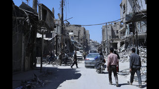 Syrian rebels hand over arms, leave another town near Douma