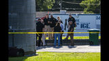 Police gather across the street from Ace China in Trenton where they are investigating a shooting in Trenton, Fla., Thursday, April 19, 2018. Someone fired through the window of a north Florida restaurant Thursday afternoon, killing a few deputies who were getting food, officials said. (Lauren Bacho/The Gainesville Sun via AP)